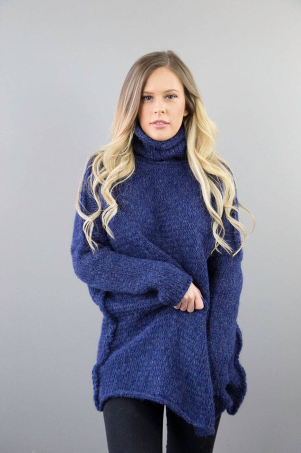 Blue oversized woman knit sweater.