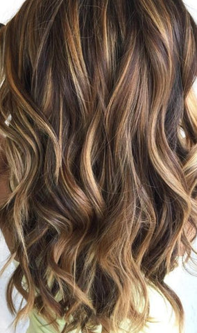 wavy curly hair extensions brown and blonde highlight hair extensions