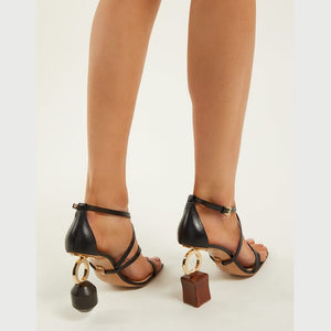 Leather sandals with asymmetric heels