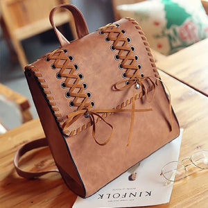 Shoe lace patterened backpack