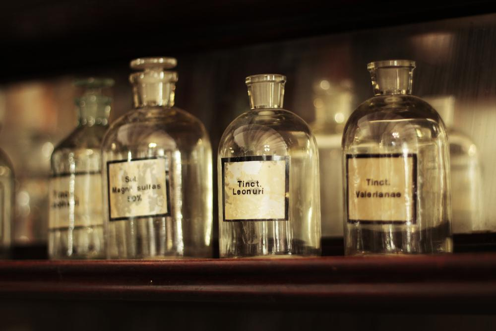 Apothecary bottles on a shelf