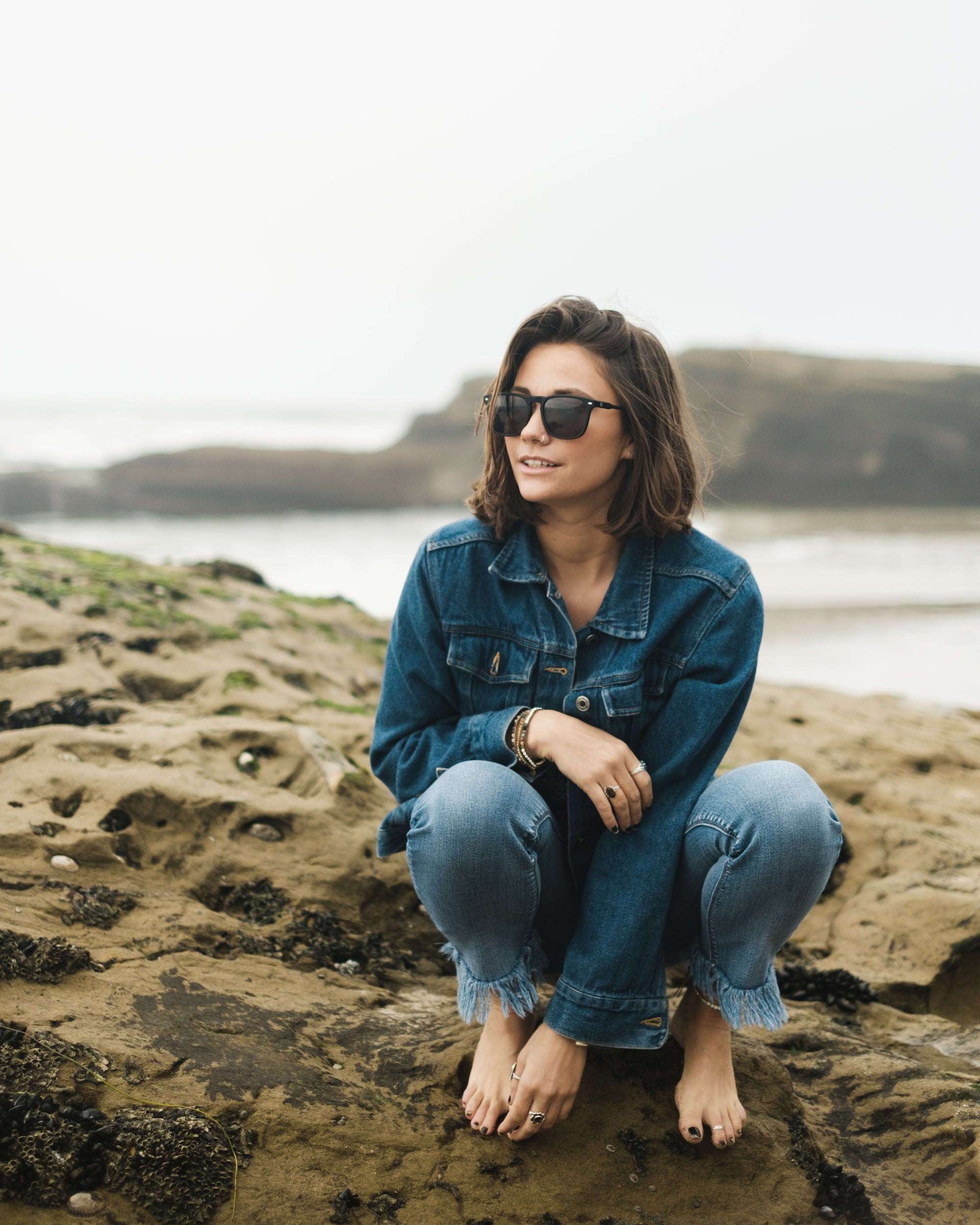 girl at tide pools wearing sala verde oceansafe sunglasses