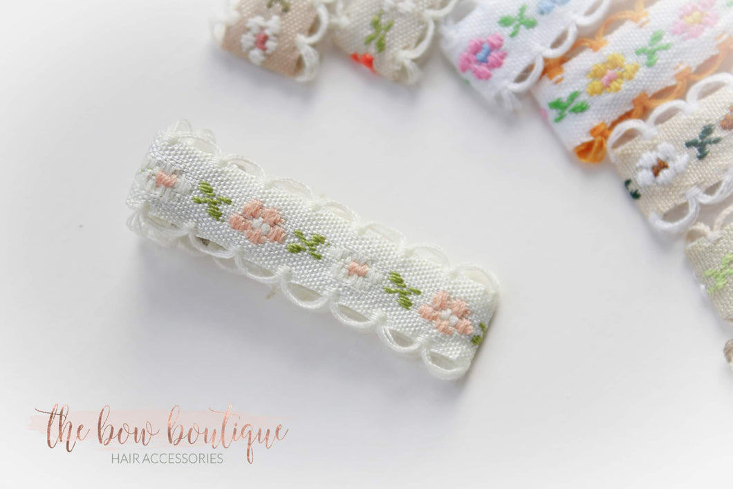 Embroided floral lined clips ( 9 colours)