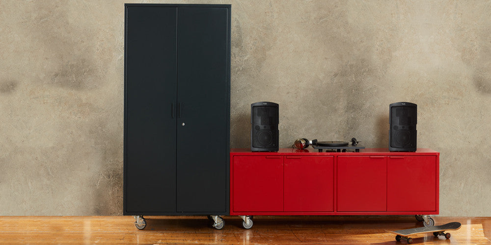 The tall red modern office credenza comes with secure locking casters, adjustable shelves, lock options and integrated cable passages for the workspace.