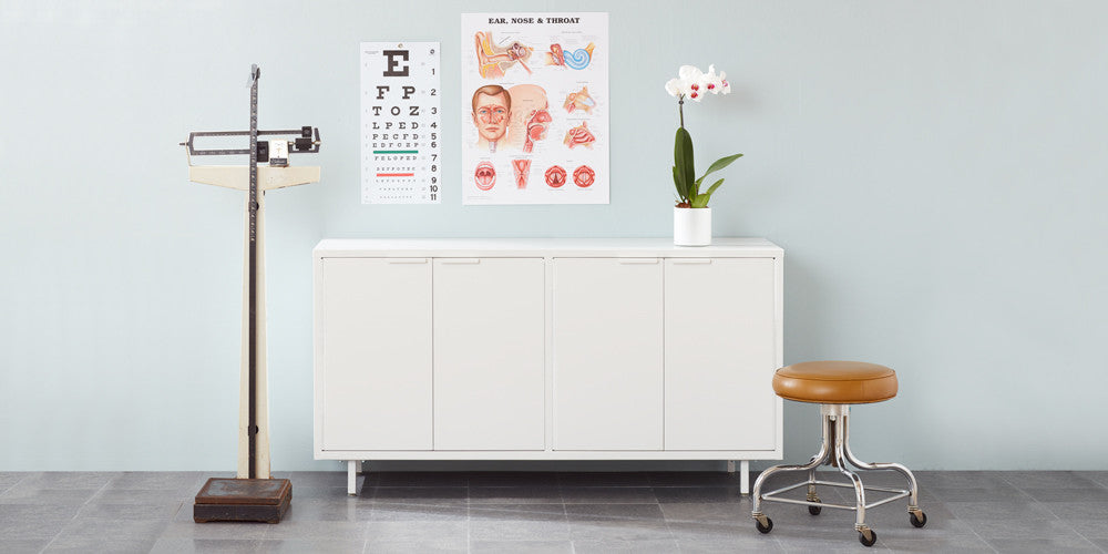 The secure white modern office credenza comes with steel legs adjustable shelves, secure lock options and integrated cable passages, perfect for doctor's offices, law firms, and other modern workplaces.