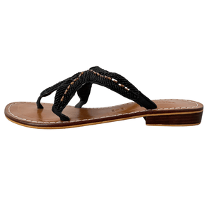 Handmade Leather Beaded Sandals are shown in Black from the side view. Leather Uppers and soles all made by hand. Beading is delicate black beads interlocked with gold beading to form a Starfish Design.