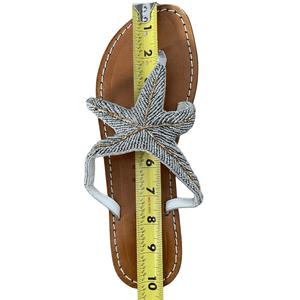 Handmade Leather Beaded Sandals are shown in Silver. Leather Uppers and soles all made by hand. Beading is delicate silver grey beads interlocked with gold beading to form a Starfish Design. Picture shows how we measure every sandal