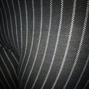 This is a close up of the black pinstripe leggings for women