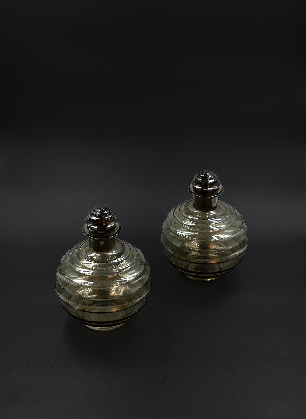 Pair of Fluted Smoked Glass Decanters