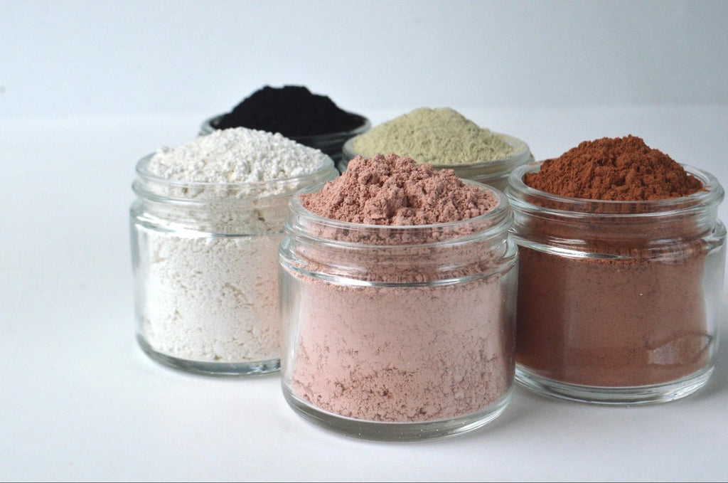 Five jars of powdered clay in different colors
