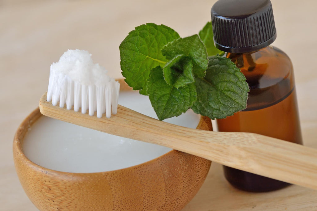 peppermint essential oil benefits: toothbrush with organic toothpaste