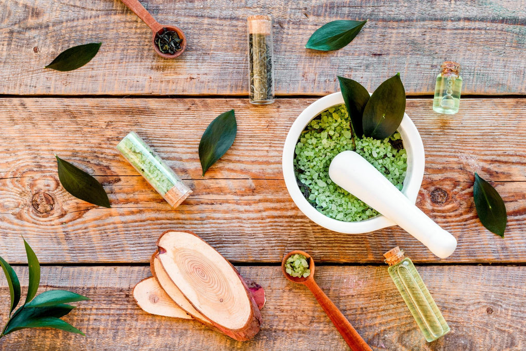 Tea tree oil for acne: tea tree oil with mortar and pestle