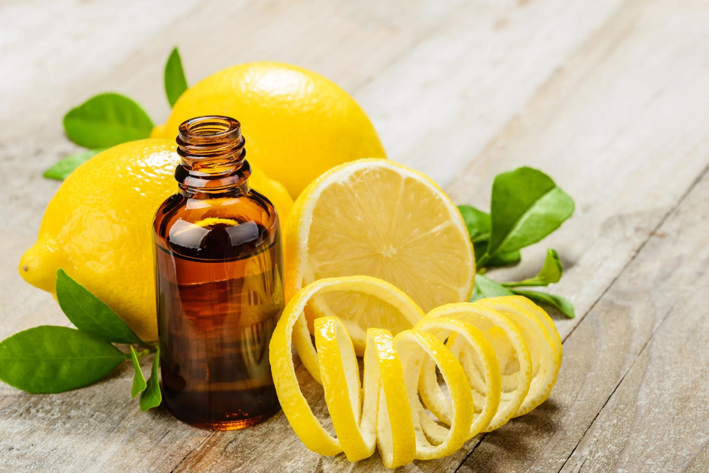 Lemon oil benefits: Bottle of lemon oil