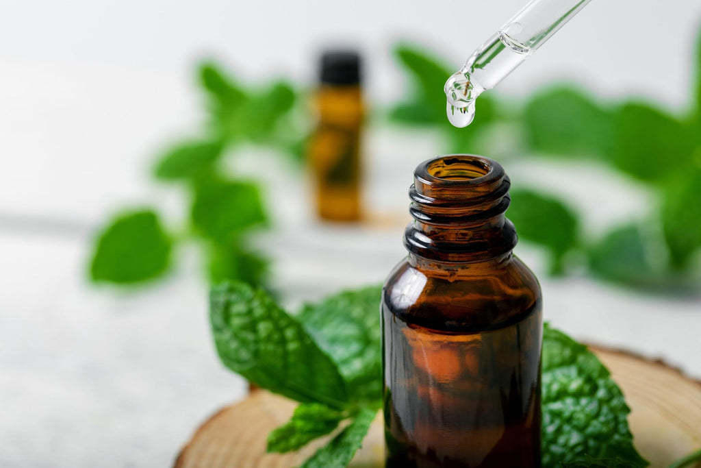 peppermint essential oil benefits: dropper with bottle