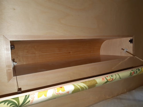 Front Storage Box with Headboard that folds down for extra storage from the inside.