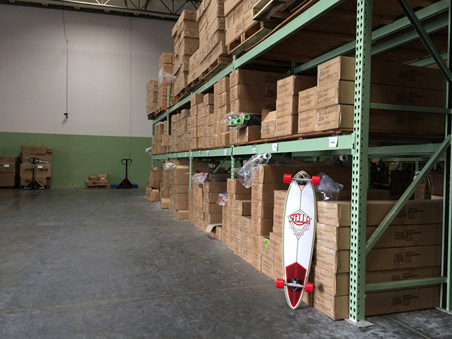 Organized warehouse with new 2015 Stella Longboard Models