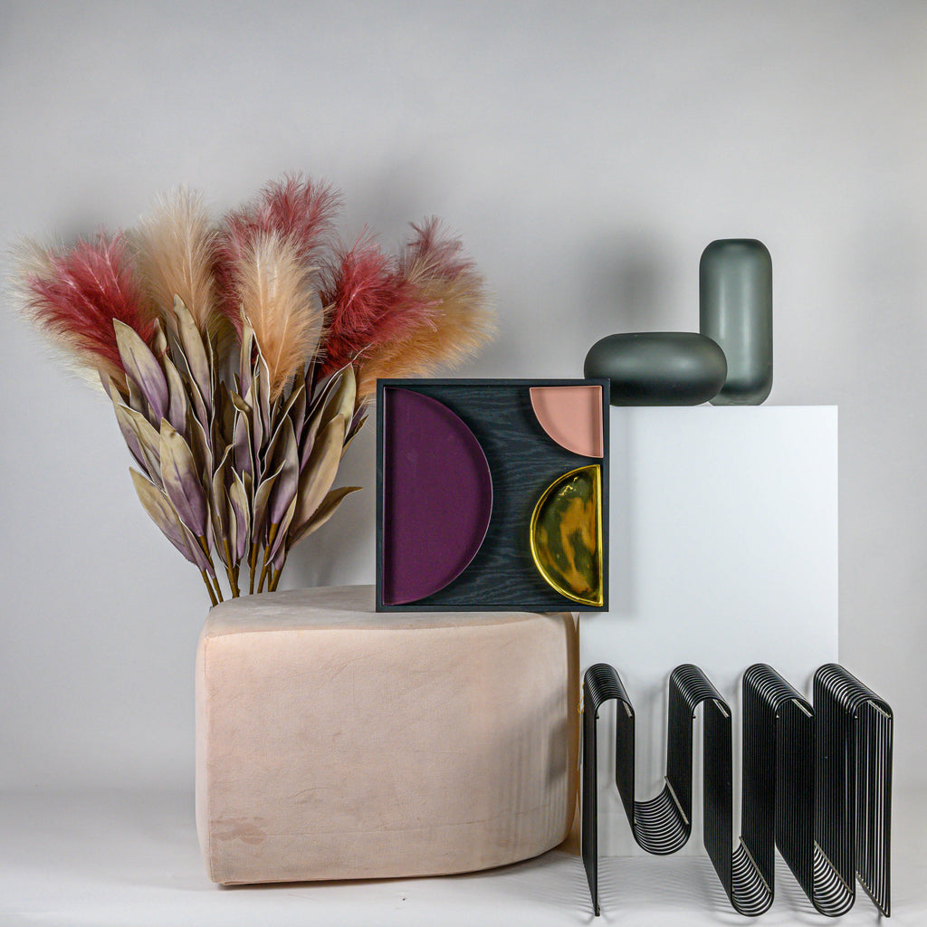 Rose Stilla Pouf, unity tray, curva magazine holder and hydria vases with Opsis faux blooms