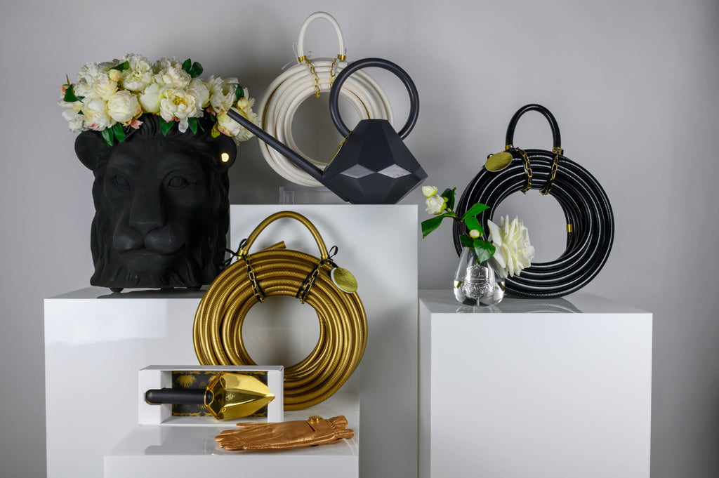 Garden Glory reindeer hose mounts, gold hoses, spades, watering cans and gardening gloves