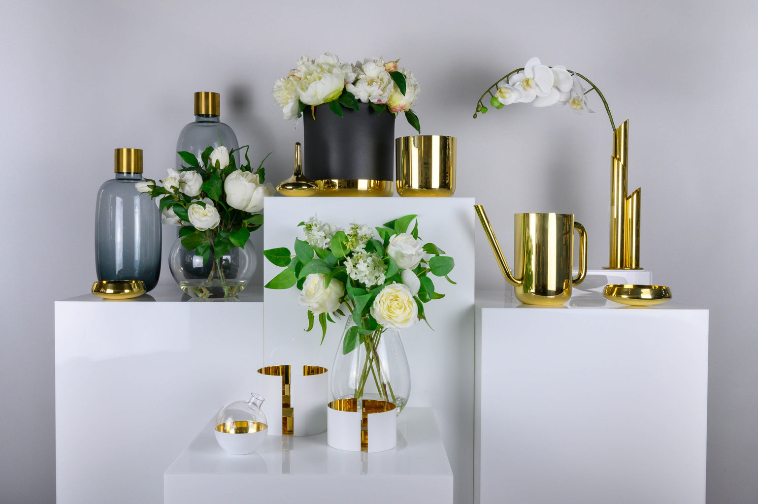 Skultuna brass objects: nurture pot plant hodlers and watering can, infinity candle holders, belle jewellery holder, damejeanne vases