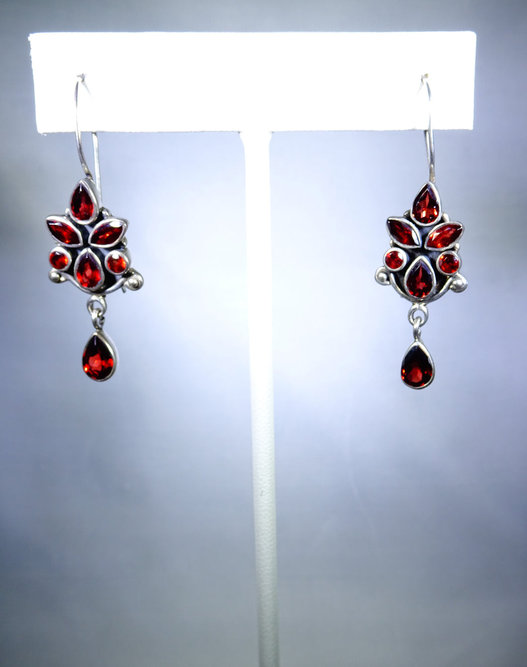 Sterling silver earring, garnet design with delicate drop