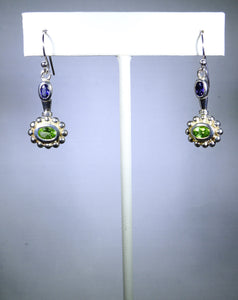 Sterling silver earring, green floral design with purple stone