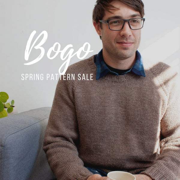 BOGO pattern sale - man in hand knit sweater sitting on a couch wearing glasses holding a coffee cup