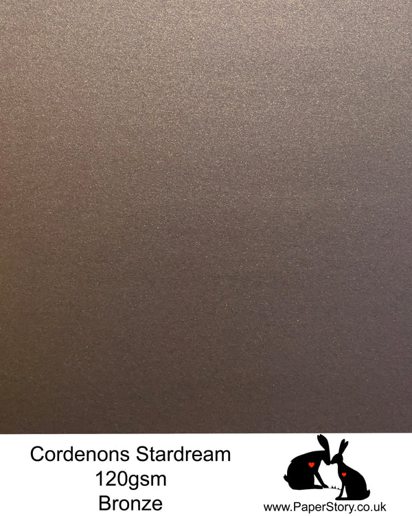 A4 Stardream 120gsm paper for Papercutting, craft, flower making  and wedding stationery. Bronze, is a stunning chocolate brown and has beautiful warm undertones with shimmering light reflection with a hint of gold. Stardream is a luxury Italian paper from Italy, it is a double sided quality Pearlescent paper with a matching colour core. FSC Certified, acid free, archival and PH Neutral
