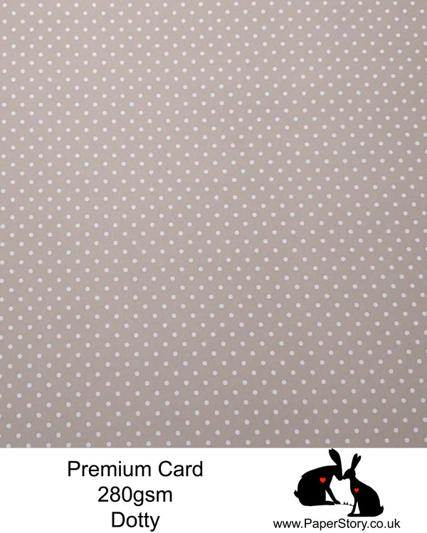 A4 Smooth card 280 gs,  single sided patterned card, with a white dotty repeating pattern, on a taupe background. Smooth card white back perfect for crafting and card making. Limited stock as now discontinued.