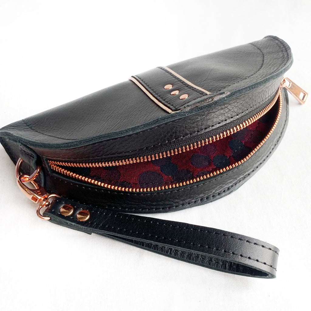 Black and rose gold taco clutch