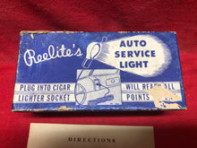 Load image into Gallery viewer, Vintage Reelite Auto Service Light 6volt Cigar Lighter Socket Plug-A-Lite NIB - Sundellauto Specialties Chevelle, El Camino, Malibu, Impala, Caprice, Biscayne, Bel Air, Camaro, Nova, Chevy II, GTO, LeMans, Tempest, Bonneville, Grand Prix, Catalina, Ventura, Skylark, Special, GS, Riviera, Gran Sport, Wildcat, Cutlass, Cutlass Supreme, 442, F-85, and Vista Cruiser Trouble light Original