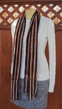 Load image into Gallery viewer, Black and copper stripes handwoven scarf with tassels made in Bend Oregon paired with a white sweater