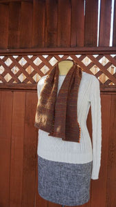 Hand dyed orange wool and grey bamboo handwoven scarf made in Bend Oregon wrapped around and paired with a white sweater
