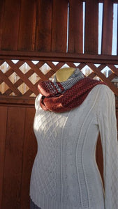 Bamboo black, white and coral handwoven scarf with tassels made in Bend Oregon wrapped around and paired white sweater