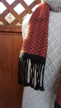 Load image into Gallery viewer, Bamboo black, white and coral handwoven scarf with tassels made in Bend Oregon wrapped around and paired white sweater