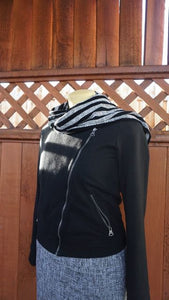 Black and white stripes handwoven scarf made in Bend Oregon wrapped around the neck and paired with a white sweater