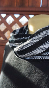 Black and white stripes handwoven scarf made in Bend Oregon wrapped around the neck and paired with a black sweater