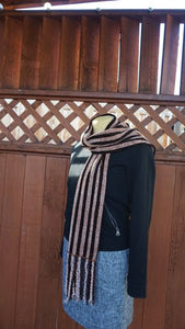 Black and copper stripes handwoven scarf with scarves made in Bend Oregon wrapped around and paired with a black sweater