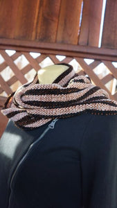 Black and copper stripes handwoven scarf made in Bend Oregon wrapped around and paired with a black sweater