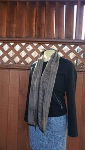 Black and brown bamboo handwoven scarf made in Bend Oregon draped around the neck and paired with an black sweater