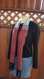 Bamboo black, white and coral handwoven scarf with tassels made in Bend Oregon wrapped around and paired black sweater