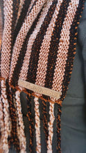 Load image into Gallery viewer, Black and copper stripes handwoven scarf with tassels made in Bend Oregon wrapped around and paired with a olive green sweater