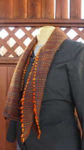 Hand dyed orange wool and grey bamboo handwoven scarf made in Bend Oregon wrapped around and paired with a green sweater