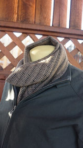 Black and brown bamboo handwoven scarf made in Bend Oregon wrapped around the neck and paired with an olive drab green