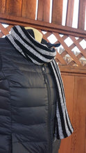 Load image into Gallery viewer, Black and white stripes handwoven scarf made in Bend Oregon wrapped around the neck and paired with a black vest