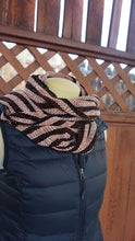 Load image into Gallery viewer, Black and copper stripes handwoven scarf with tassels made in Bend Oregon wrapped around and paired with a black vest
