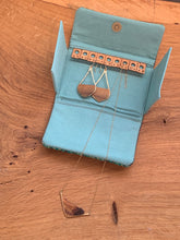 Load image into Gallery viewer, Handwoven tea stripped cotton fabric sewn with wool and cork to organize your jewelry during travel. Includes a pocket to keep necklace pendents from becoming entangled and store your rings