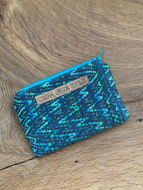 Teal, blue and green hand dyed wool and dark grey bamboo handwoven fabric sewn into a small pouch that can be used for storage of coins, credit cards and other smaller items
