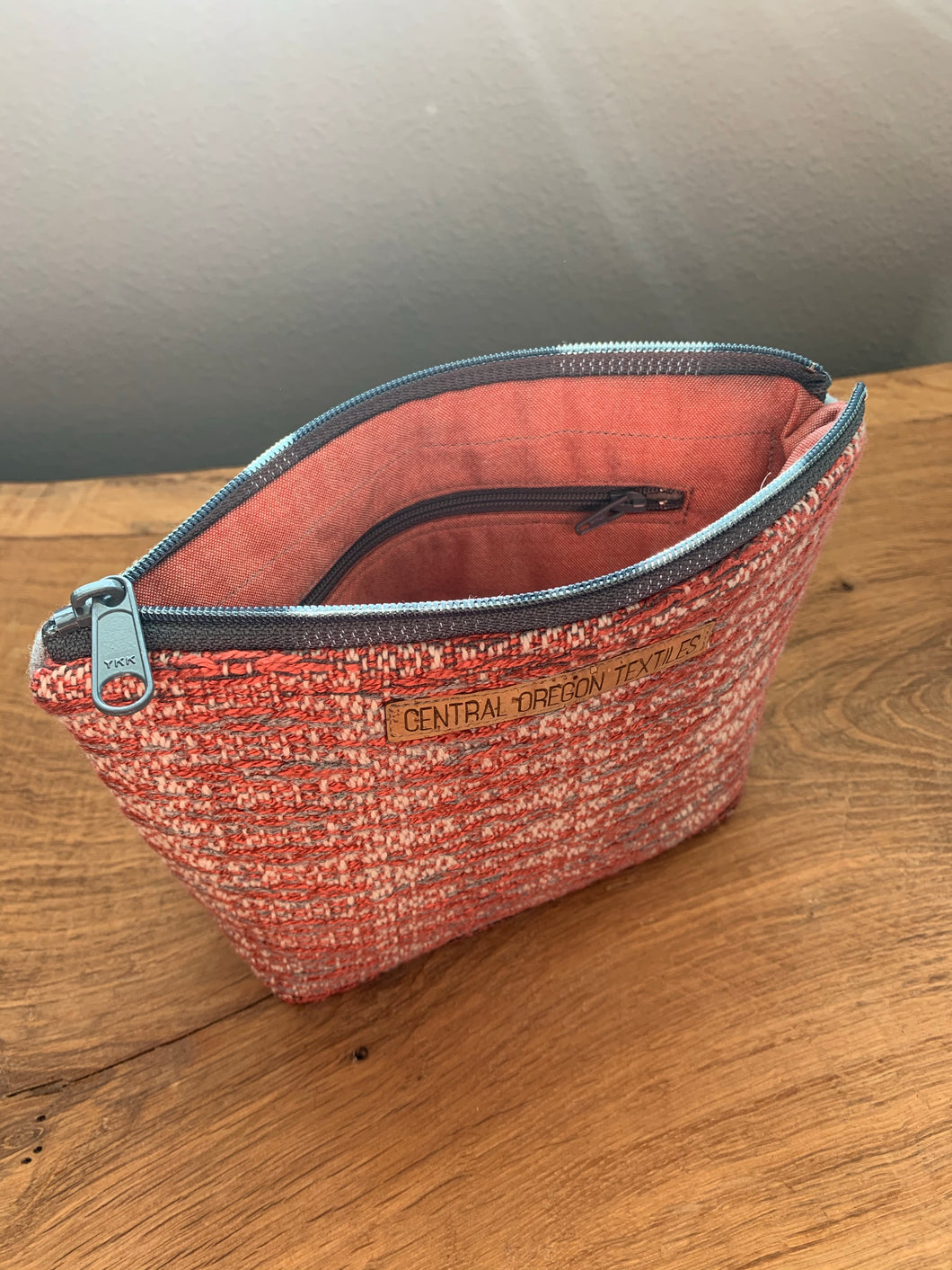 Handwoven cotton and bamboo fabric sewn with wool into a gusseted cosmetic bag. This bag is great for cosmetics and crafts. Includes an internal pocket to keep smaller items organized.