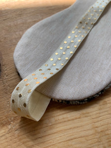 Handwoven eye mask made from handwoven beige, sage green and black bamboo gold elastic band
