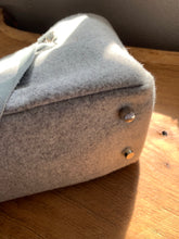 Load image into Gallery viewer, Handwoven cotton and wool handbag made with leather straps. Includes an internal pocket to keep small items organized.